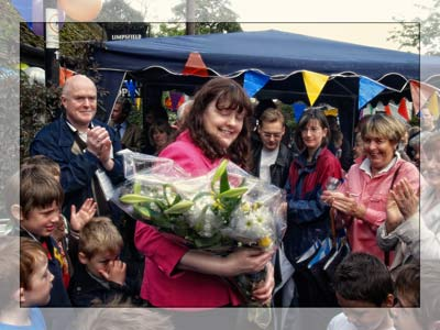 Former manager Jane receives flowers at the 10th anniversary celebration in 2009